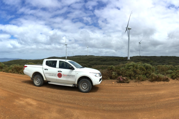Ute in front of a wind farm where Geomotion provided a monitoring system